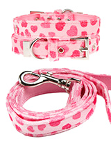 Pink Hearts Fabric Collar & Lead Set - This Pink Hearts collar & lead set is a perfect girly accessory. It is a contemporary style and the pattern is on trend. It is lightweight and incredibly strong. The collar has been finished with chrome detailing including the eyelets and tip of the collar. A matching lead, harness and bandana are a...