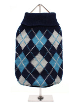 Blue Argyle Sweater - Knitted blue sweater with a baby blue and white diamond pattern. The Argyle pattern has seen a resurgence in popularity in the last few years due to its adoption by Stuart Stockdale in collections produced by luxury clothing manufacturer, Pringle of Scotland. The rich Scottish heritage will give you...